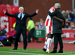 Manchester United manager Jose Mourinho shares a joke with his former player Kurt Zouma as Stoke City manager Mark Hughes reacts in frustration  - Mandatory by-line: Matt McNulty/JMP - 09/09/2017 - FOOTBALL - Bet365 Stadium - Stoke-on-Trent, England - Stoke City v Manchester United - Premier League