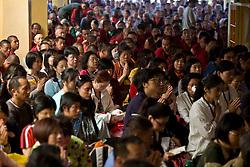INDIA - Dalai Lama <br /> Buddhists attend a morning prayer ceremony with Dalai Lama in Dharamsala, India, May 26, 2009.