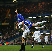 JOHN TERRY TAKES A FREE RIDE FROM KEVIN DAVIES-BARCLAYS PREMIERSHIP-CHELSEA V BOLTON - <br />20/11/04-COLORSPORT-KIERAN GALVIN