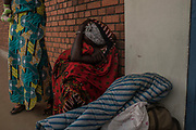 Godeliva Mukamazimpaka cries outside the room where her son Emmanuel Cyuzuzo, 22, passed away due to complications stemming from a severely damaged heart valve and failing liver and kidneys. Mr. Cyuzuzo was scheduled to have surgery the next day.<br /> <br /> Rheumatic heart disease is damage to one or more heart valves that stems from inadequately treated strep throat. Left untreated, rheumatic heart disease leads to heart failure.
