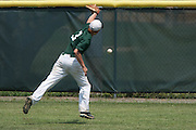 West Deptford's Jason Roselli misses a catch in right-field during a elimination bracket game of the Eastern Regional Senior League tournament held in West Deptford on Monday, August 8.
