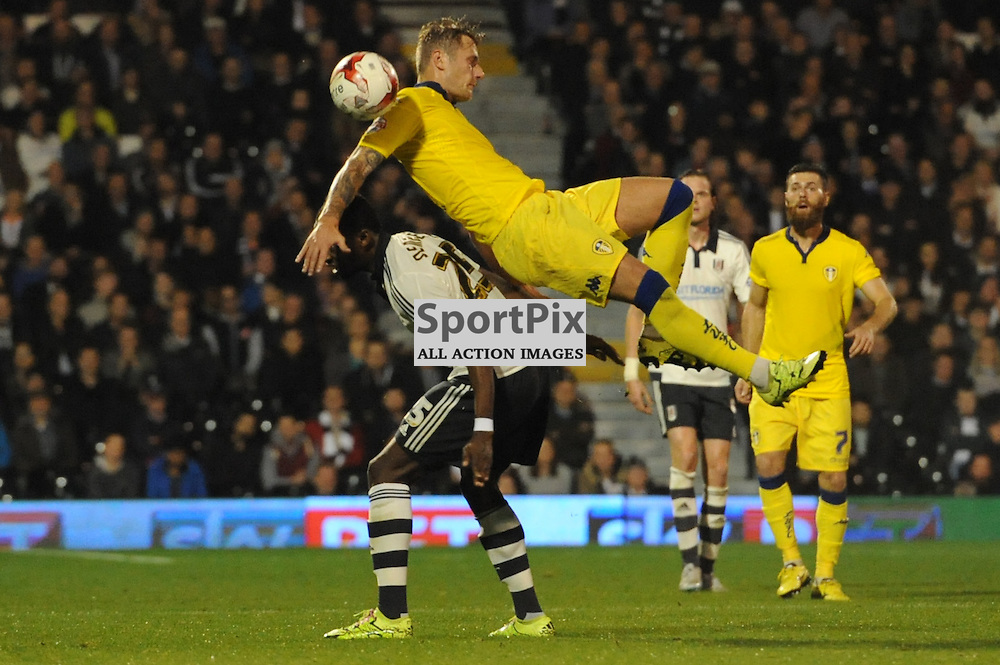 Fulhams Moussa Dembele and Leeds Liam Cooper in action during Fulham v Leeds United game in the Sky Bet Championship at Craven Cottage on the 21st October 2015.