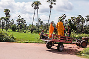 """Monks on tractor trailer on the way to Preah Da, """"Num Banh Chok village"""", Siem Reap"""