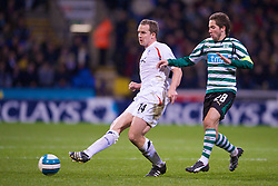BOLTON, ENGLAND - Thursday, March 6, 2008: Bolton Wanderers' Kevin Davies and Sporting Clube de Portugal's Joa?o Moutinho during the UEFA Cup Round of 16 1st Leg match at the Reebok Stadium. (Pic by David Rawcliffe/Propaganda)