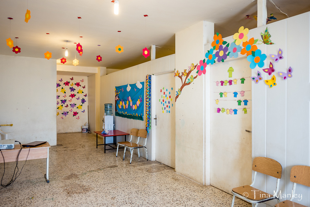 School for Syrian refugees in a garage under apartment building in Minyara, Lebanon.