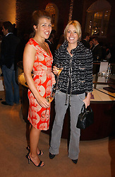 Left to right, AMBER NUTTALL and CAROLINE HABIB at a party to celebrate 100 years of Chinese Cinema hosted by Shangri-la Hotels and Tartan Films at Asprey, New Bond Street, London on 25th April 2006.<br />