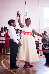 Nessara Walcott and K'Vounte Hughes demonstrate the Merengue for parents, students, and staff at the Juanita Gardine Elementary School Dancing Classrooms VI Culminating Event.  16 December 2015.  Christiansted, St. Croix.   © Aisha-Zakiya Boyd