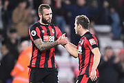 Ryan Fraser (24) of AFC Bournemouth celebrates the 2-1 win at full time with Steve Cook (3) of AFC Bournemouth during the Premier League match between Bournemouth and Everton at the Vitality Stadium, Bournemouth, England on 30 December 2017. Photo by Graham Hunt.