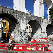 The Arcos da Lapa. The aquaduct dominates Lapa, a suburb of Rio de Janeiro, built in 1724 to transport water from the Santa Teresa forest to the public drinking fountain near Largo da Carioca, Trams now from across the arches from the city to Santa Teresa and back. Rio de Janeiro, Brazil. 19th July 2010. Photo Tim Clayton..