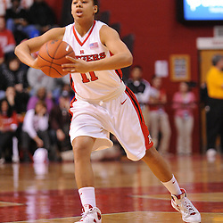 Jan 31, 2009; Piscataway, NJ, USA; Rutgers guard Nikki Speed (11) passes to teammate guard Epiphanny Prince (not pictured) during the first half of South Florida's 59-56 victory over Rutgers in NCAA women's college basketball at the Louis Brown Athletic Center