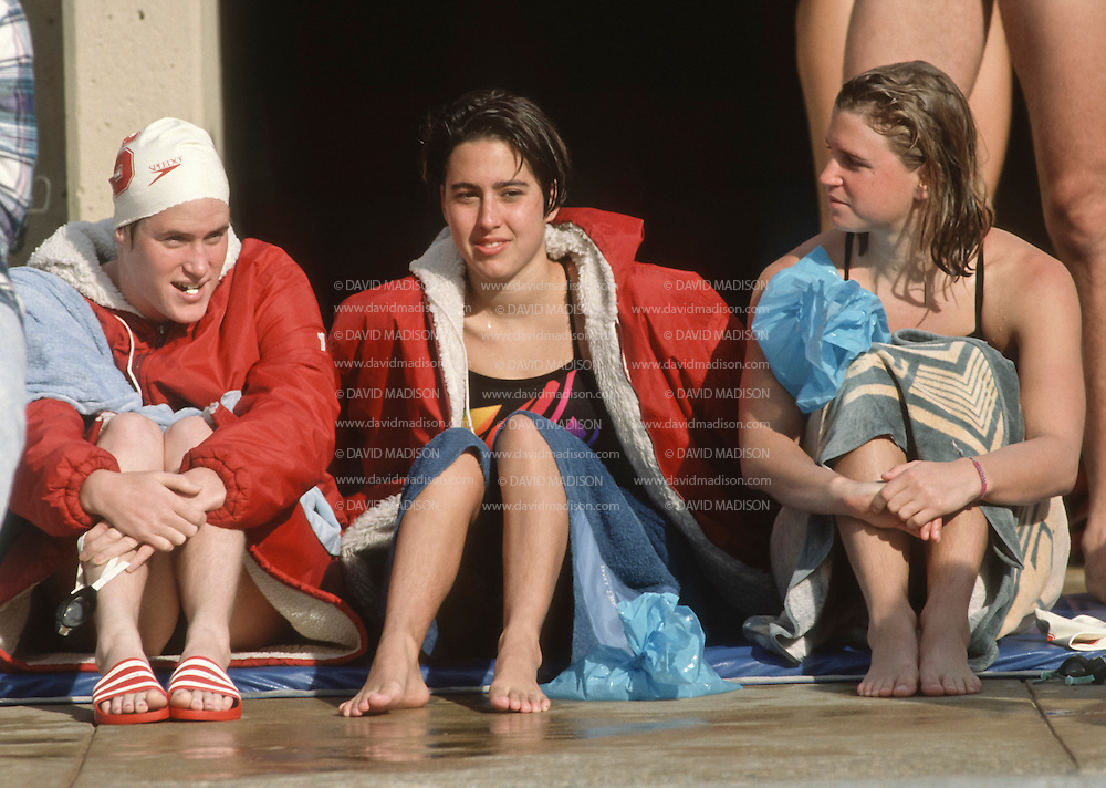 PALO ALTO, CA -  JANUARY 1990:  Janet Evans of Stanford University sits with her teammates during an NCAA swimming event in January 1990 at deGuerre Pool at Stanford University in Palo Alto, California.   (Photo by David Madison/Getty Images) *** Local Caption *** Janet Evans