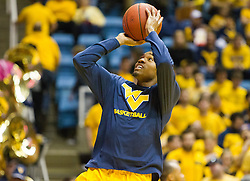 Feb 6, 2016; Morgantown, WV, USA; West Virginia Mountaineers guard Daxter Miles Jr. (4) warms up before their game against the Baylor Bears at the WVU Coliseum. Mandatory Credit: Ben Queen-USA TODAY Sports