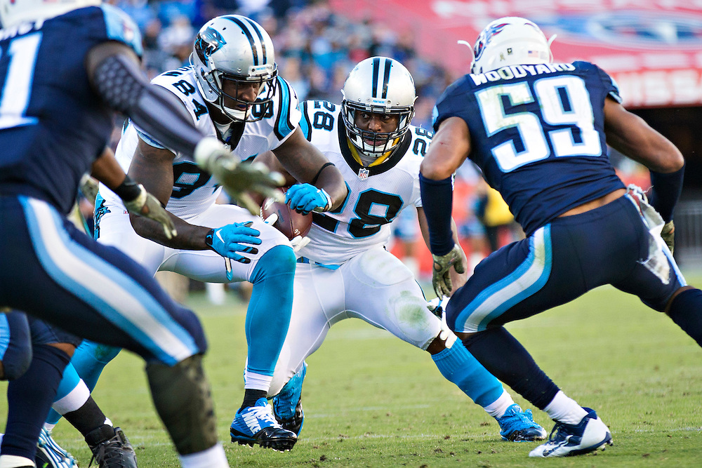 NASHVILLE, TN - NOVEMBER 15:  Jonathan Stewart #28 runs behind the blocking of Ed Dickson #84 of the Carolina Panthers against Wesley Woodyard #59 of the Tennessee Titans at Nissan Stadium on November 15, 2015 in Nashville, Tennessee.  (Photo by Wesley Hitt/Getty Images) *** Local Caption *** Jonathan Stewart; Ed Dickson; Wesley Woodyard