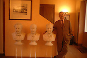 L to R. Busts: Louis Vuitton, Georges Vuitton, Gaston Louis Vuitton, standing:  S. Patrick Louis Vuitton. Visit to the Louis Vuitton home, headquarters and workshop, Paris.  24 January  2006.  ONE TIME USE ONLY - DO NOT ARCHIVE  © Copyright Photograph by Dafydd Jones 66 Stockwell Park Rd. London SW9 0DA Tel 020 7733 0108 www.dafjones.com