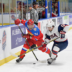 WHITBY, - Dec 17, 2015 -  Game #10 - United States vs. Russia at the 2015 World Junior A Challenge at the Iroquois Park Recreation Complex, ON. Artur Kayumov #24 of Team Russia battles for the puck with Spenser Young #12 of Team United States during the first period.<br /> (Photo: Shawn Muir / OJHL Images)