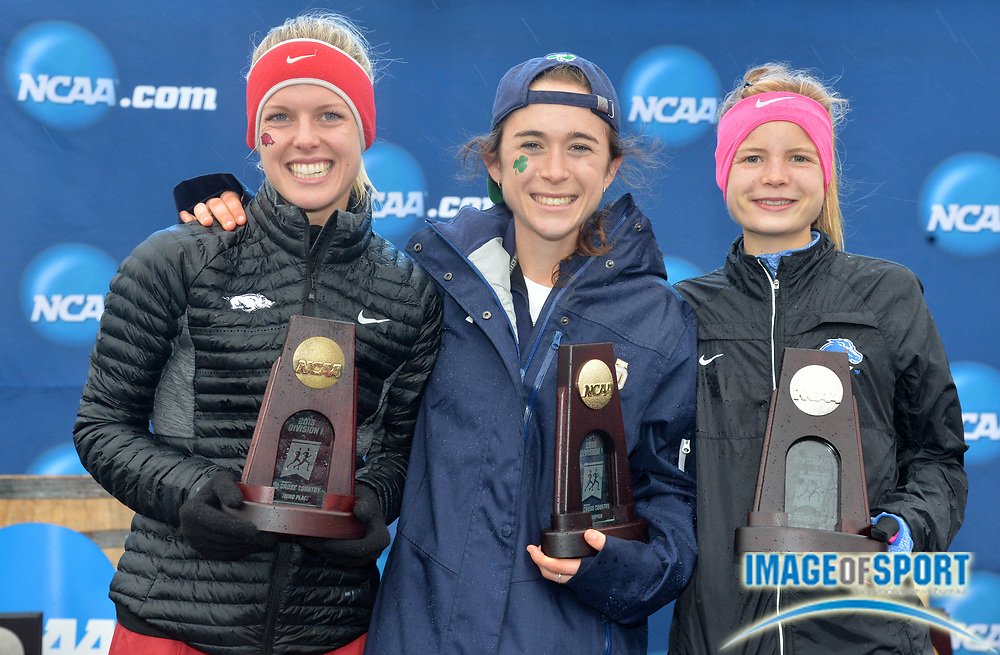 Nov 21, 2015; Louisville, KY, USA; Womens winner Molly Seidel of Notre Dame (center) poses with runner=up Allie Ostrander of Boise State (right) and third-place finisher Dominqiue Scott of Arkansas during the 2015 NCAA cross country championships at Tom Sawyer Park.