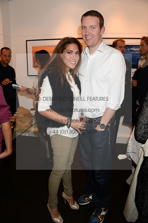 JAMES & LILY HODGES at a private view of Photographs by Julian Lennon held at The Little Black Gallery, 13A Park Walk, London SW10 on 17th September 2013.