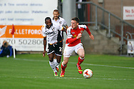 Crewe Alexandre&rsquo;s Matt Tootle gets away from from Port Vale&rsquo;s Mark Marshall. Skybet football league one match, Crewe Alexandra v Port Vale at the Alexandra Stadium in Crewe on Saturday 13th Sept 2014.<br /> pic by Chris Stading, Andrew Orchard sports photography.