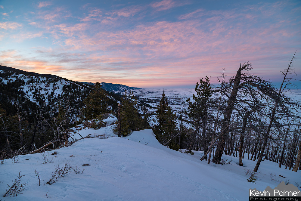 A colorful sunset fills the sky as seen from an unnamed peak in the Bighorn Mountains. To get here required snowshoeing up Red Grade Road.