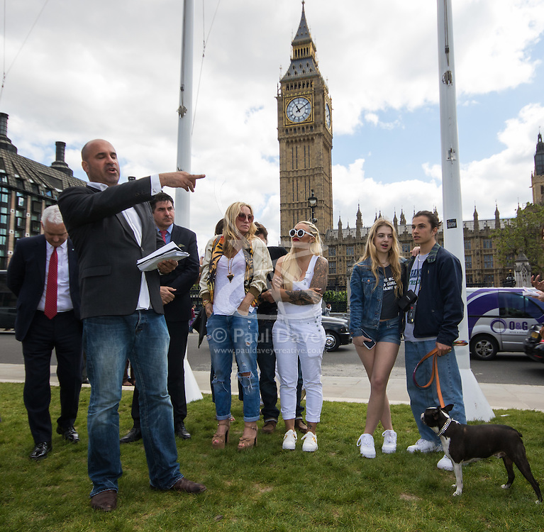 """Westminster, London, May 24th 2016. Animal rights protesters from """"Boycott Dogs4Us"""" protest outside Parliament against puppy farming and third party puppy selling as the Environment, Food and Rural Affairs Sub-Committee are investigating the sale of dogs as part of their animal welfare inquiry. PICTURED: TV Vet Marc Abraham addresses the crowd"""