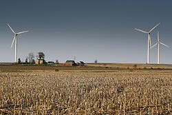 26 April 2008:   A farm is nestled in the side of a hill surrounded by wind turbines that are a part of the Twin Grove wind farm east of Bloomington Illinois..