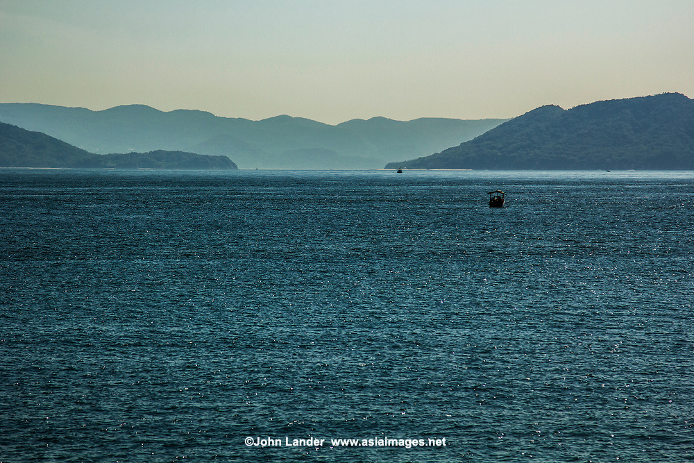 """The Inland Sea, or """"Seto Naikai"""" as it is known in Japanese is the body of water separating Honshu, Shikoku  and Kyushu - Japan's main islands.  The Inland Sea, because of its calm waters and strategic location among the main islands, has always been an important transportation link for Japan."""