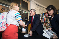"© Licensed to London News Pictures. 16/11/2017. Manchester, UK. Former British Prime Minister GORDON BROWN signs copies of his book during a promotional tour for his book , "" My Life, Our Times "", at the Manchester Central Library . Photo credit: Joel Goodman/LNP"