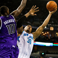 December 15, 2010; New Orleans Hornets power forward David West (30) shoots over Sacramento Kings center Samuel Dalembert (10) during the first half at the New Orleans Arena.  Mandatory Credit: Derick E. Hingle