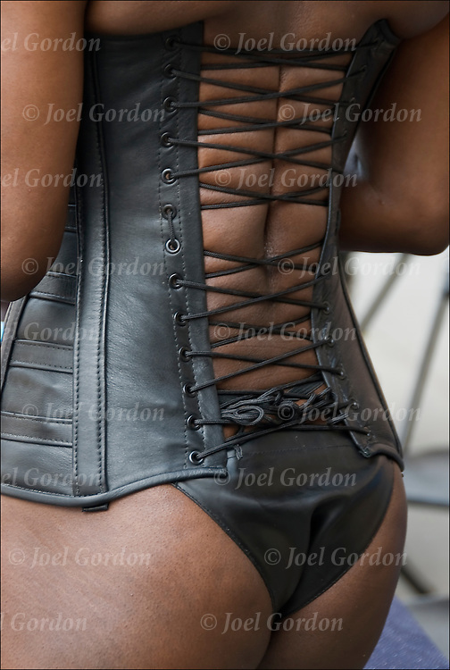 She is making a fashion statement by wearing S&M leather corset @ Folsom Street S&M street fair