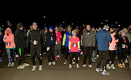 East Meadow, New York, USA. December 31, 2014. Runners wait until the stroke of twelve midnight at the Start Line at the 5K New Year's Eve DASH to support the Long Island Council on Alcoholism and Drug Dependence (LICADD) at the Twin RInks Ice Center at Eisenhower Park in Long Island. A Skatin' New Year's Eve event started hours earlier and a New Year's Eve Party, open to runners, family and friends continued until 2:30 a.m.