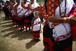 August 9, 2017 - Lalitpur, Nepal - A girl from ethnic Newar community takes part in a parade during Mataya festival, the festival of lights, to commemorate the departed, in Lalitpur. (Credit Image: © Skanda Gautam via ZUMA Wire)