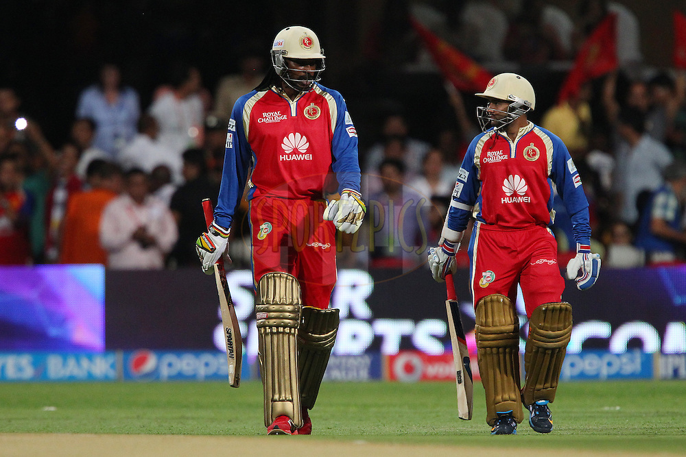 Chris Gayle of the Royal Challengers Bangalore walks out with Parthiv Patel of the Royal Challengers Bangalore during match 24 of the Pepsi Indian Premier League Season 2014 between the Royal Challengers Bangalore and the Sunrisers Hyderabad held at the M. Chinnaswamy Stadium, Bangalore, India on the 4th May  2014<br /> <br /> Photo by Ron Gaunt / IPL / SPORTZPICS<br /> <br /> <br /> <br /> Image use subject to terms and conditions which can be found here:  http://sportzpics.photoshelter.com/gallery/Pepsi-IPL-Image-terms-and-conditions/G00004VW1IVJ.gB0/C0000TScjhBM6ikg