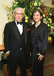 Comedian DAVE ALLEN and MISS KARIN STARKE at a dinner in London on 19th February 1998.MFO 16