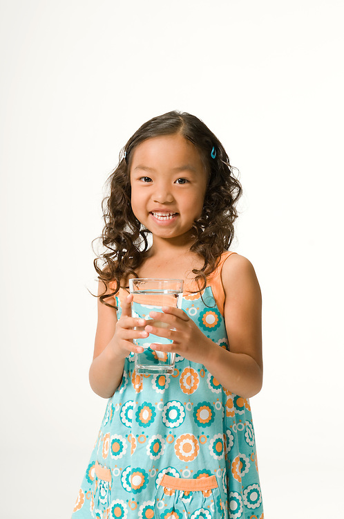 Child drinking glass of water.