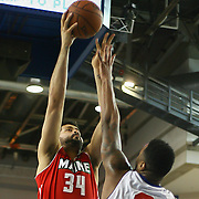 Maine Red Claws Forward Vitor Faverani (34) take short range shot as Philadelphia 76ers assignee Forward Arnett Moultrie (3) defends in the first half of an NBA D-league regular season basketball game between the Delaware 87ers (76ers) and the Maine Red Claws (Boston Celtics) Tuesday, Feb. 4, 2014 at The Bob Carpenter Sports Convocation Center, Newark, DE