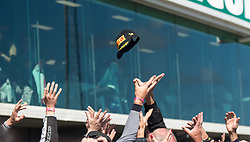 February 25, 2018 - Melbourne, Victoria, Australia - Fans try to catch the hat of British rider Jonathan Rea (#1) of Kawasaki Racing Team after he threw it from the podium after the second race on day 3 of the opening round of the 2018 World Superbike season at the Phillip Island circuit in Phillip Island, Australia. (Credit Image: © Theo Karanikos via ZUMA Wire)