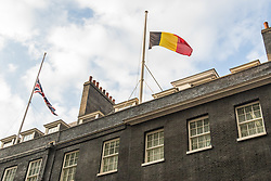 Downing Street, London, March 22nd 2016. The British and Belgian flags fly at half mast in Downing Street in solidarity with the people of Belgium following the terrorist attacks in Brussels. &copy;Paul Davey<br /> FOR LICENCING CONTACT: Paul Davey +44 (0) 7966 016 296 paul@pauldaveycreative.co.uk