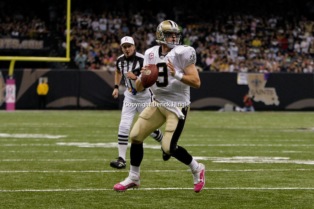 2009 October 04: New Orleans Saints quarterback Drew Brees (9) scrambles out of the pocket and looks to throw during a 24-10 win by the New Orleans Saints over the New York Jets at the Louisiana Superdome in New Orleans, Louisiana.