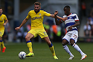 Stuart Dallas of Leeds United blocks Olamide Shodipo of QPR from the ball. Skybet EFL championship match, Queens Park Rangers v Leeds United at Loftus Road Stadium in London on Sunday 7th August 2016.<br /> pic by John Patrick Fletcher, Andrew Orchard sports photography.