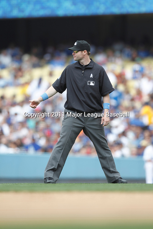 LOS ANGELES - JUNE 19:  Second base umpire Mike Estabrook #83 of the Los Angeles Dodgers works second base during the game against the Houston Astros at Dodger Stadium on Sunday, June 19, 2011 in Los Angeles, California.  The Dodgers defeated the Astros 1-0.  (Photo by Paul Spinelli/MLB Photos via Getty Images) *** Local Caption *** Mike Estabrook