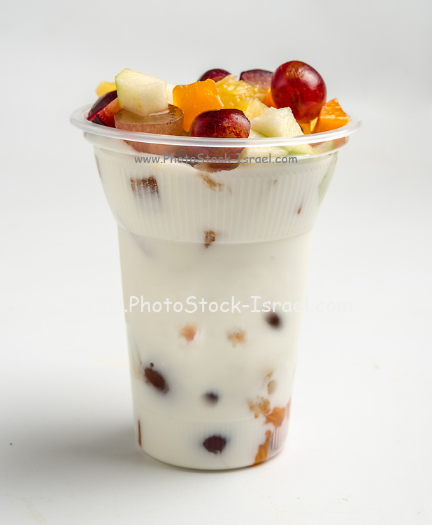 Fruit and yogurt in a plastic cup as a take away snack