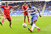 Reading FC striker Ola John plays the ball into the box during the Sky Bet Championship match between Reading and Cardiff City at the Madejski Stadium, Reading, England on 19 March 2016. Photo by Mark Davies.