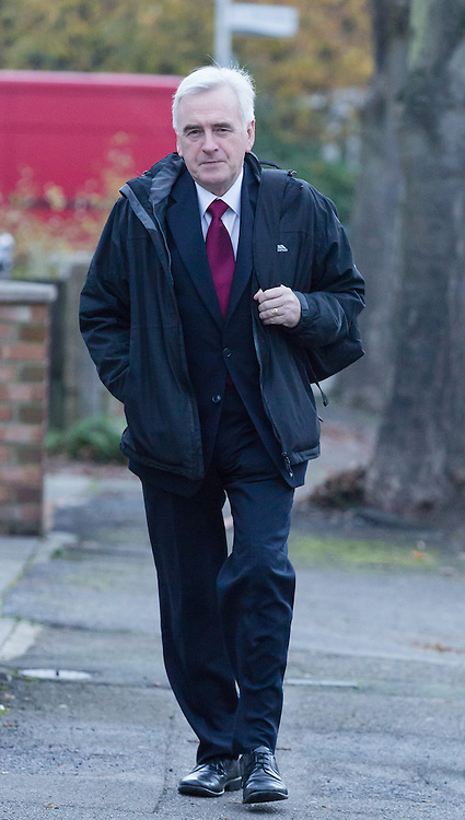 © Licensed to London News Pictures. 23/11/2016. LONDON, UK.  Labour Shadow Chancellor, JOHN MCDONNELL leaving his home for parliament this  morning, where the Chancellor, Phillip Hammond will present his first Autumn Statement budget announcement later today which will be followed by a response from Shadow Chancellor, John McDonnell.  Photo credit: Vickie Flores/LNP