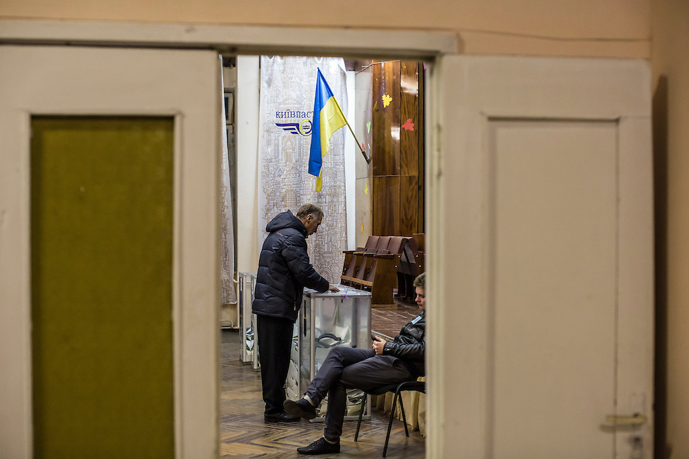 KIEV, UKRAINE - OCTOBER 26: A voter casts his ballot for parliamentary elections at a polling station on October 26, 2014 in Kiev, Ukraine. Although a low turn out is expected in the east of the country, amid continued fighting between Ukrainian forces and pro-Russian seperatists, Ukraine is expected to elect a pro-western parliament in a further move away from Russian influence. (Photo by Brendan Hoffman/Getty Images) *** Local Caption ***