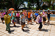 Villagers dance in a procession around the ordination hall to begin the festivities for the 2nd day of Songkran in rural Thailand. April 14, 2017. PHOTO BY LEE CRAKER