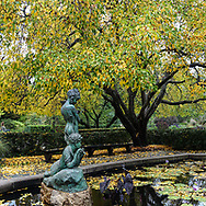The Burnett Memorial fountain by artist Bessie Potter Vonnoh (1872-1955), which honors the well-known children's book author Frances Eliza Hodgson Burnett (1849-1924), at the Conservatory Garden in Central Park.