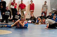Wrestling Tournament at Winnisquam Regional High School January 7, 2012.  (Karen Bobotas/ for the Concord Monitor)