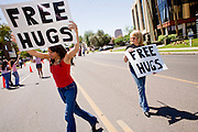 """14 APRIL 2007 -- PHOENIX, AZ: Women give out """"free hugs"""" at the annual Gay Pride Parade in Phoenix, AZ. Thousands of people attended the annual event. Photo by Jack Kurtz / ZUMA Press"""