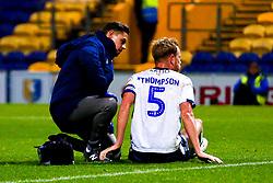 An injured Adam Thompson of Bury - Mandatory by-line: Ryan Crockett/JMP - 04/12/2018 - FOOTBALL - One Call Stadium - Mansfield, England - Mansfield Town v Bury - Checkatrade Trophy