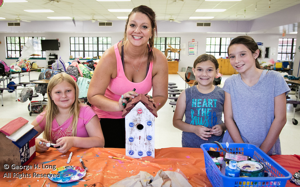 Campers decorate birdhouses during the Abita Springs Middle School Summer Camp.